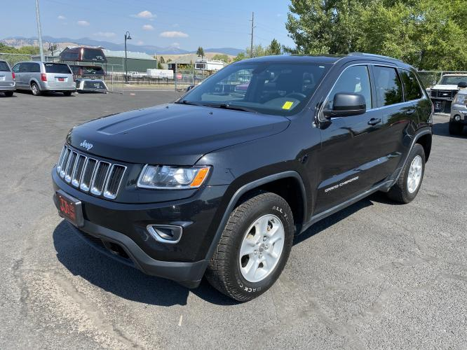 2015 Black Jeep Grand Cherokee Laredo (1C4RJFAGXFC) with an 3.6L engine, Automatic transmission, located at 100 S Russell St., Missoula, MT, 59801, (406) 721-7467, 46.870090, -114.018066 - Photo #0