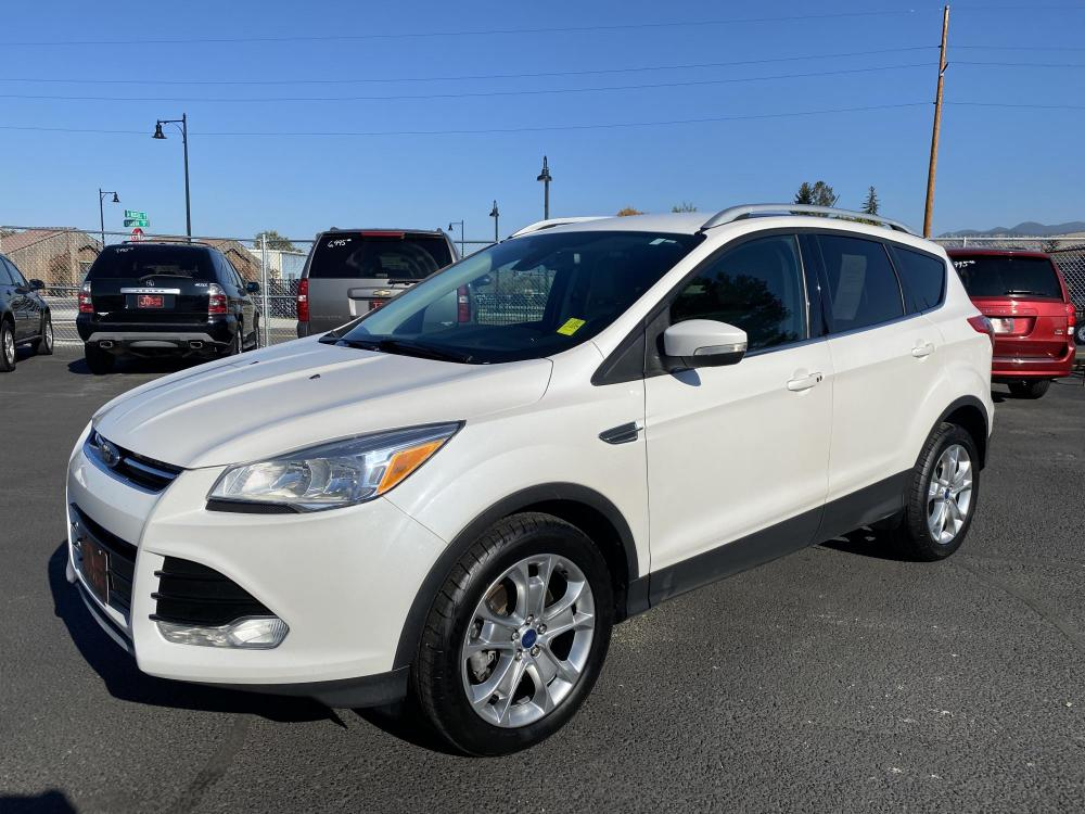 2014 White Ford Escape Titanium (1FMCU9J93EU) with an 2.0L engine, Automatic transmission, located at 100 S Russell St., Missoula, MT, 59801, (406) 721-7467, 46.870090, -114.018066 - Photo #0